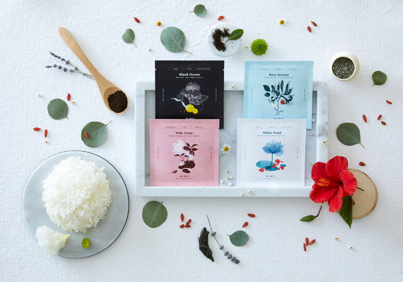 Photograph of 4 illustrated packets of tea
